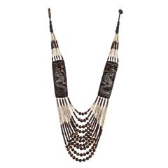 Purpledip Multistrand Necklace With Stunning Bone Carving of Dragons, Classy Cool Contemporarry Look (30107)