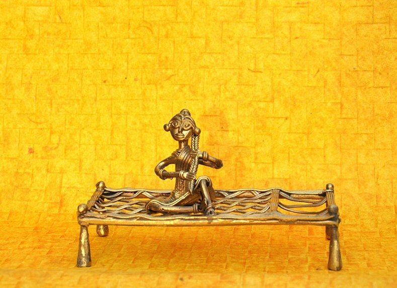 DOKRA CRAFT - WOMAN  SITTING ON COT