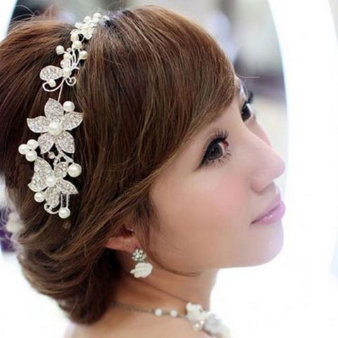 Elegant bridal floral hair accessories with beads and crystals.