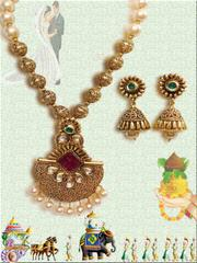 Nakshi Balls With Stunning Golden Kundan Pendant With Adorable Earrings