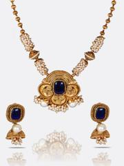 Gold Plated Pearl Necklace Enhancing Blue Emerald Stone At Center With Earings Jewellery