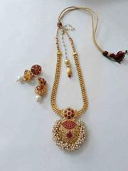 Exotic pearl studded pendant set with earrings