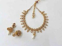 Beautiful designed pearl studded pendant set