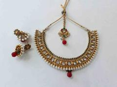 Gold finish choker set with kundan and onyx stone
