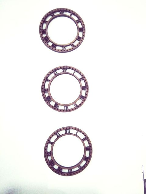WE Small Roman Clock 1.5 inches in size pack of 03.