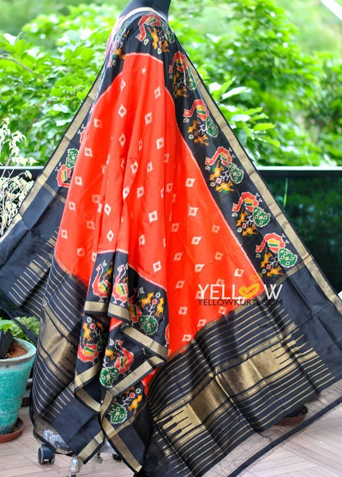 Pure silk Ikkat dupatta in vibrant combination of orange and black with peacock border