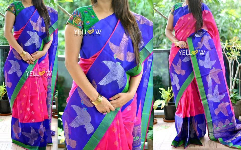 Pink and blue Kuppadam handloom silk saree with green edging and golden and silver birds border and butis allover the saree