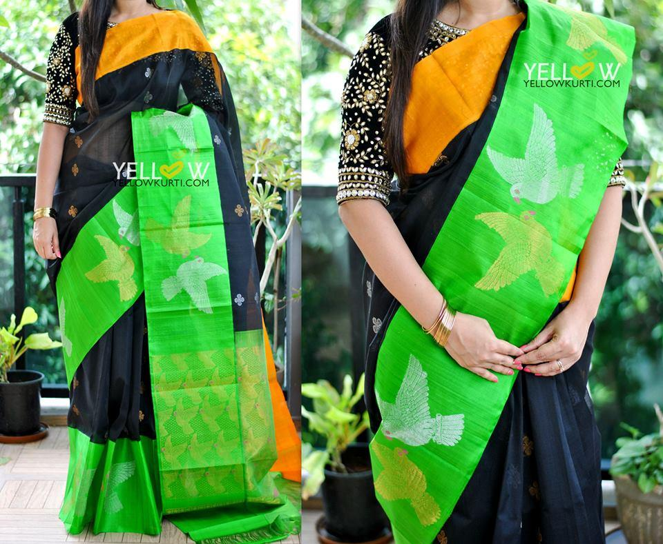 Black Kuppadam handloom silk saree with dual shaded borders highlighted with silver and gold flying birds