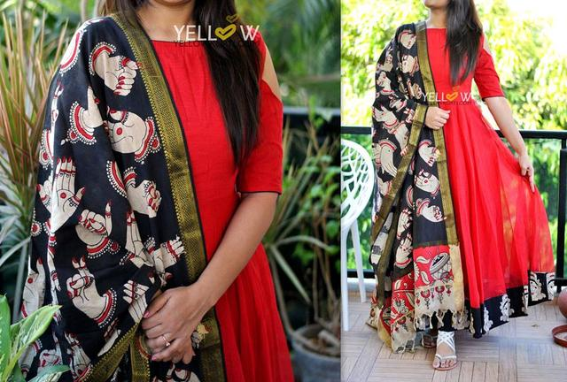 Bright Red jute cold shoulder dress with kalamkari edging to the flare teamed up with mangalagiri cotton hand