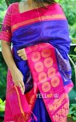 Purple Kuppadam handloom silk saree with blue border intricately woven with gold zari