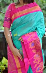 Sea Green Kuppadam handloom silk saree with blue border intricately woven with silver and gold zari creepers