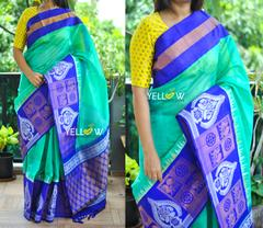 Cyan Kuppadam handloom silk saree with blue border intricately woven with silver and gold zari creepers