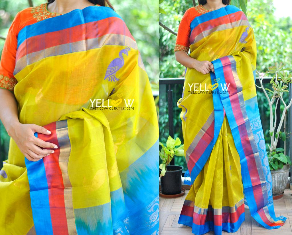 Yellow Kuppadam handloom silk saree with blue border intricately detailed with silver and golden motifs