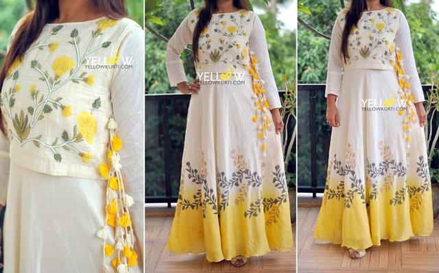Long Off-white muslin cotton Kurti with detachable jacket intricately embroidered floral creepers and side tassels.