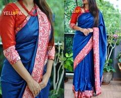Navy blue rawsilk saree with red banaras and paisley thread work borders running all though the saree