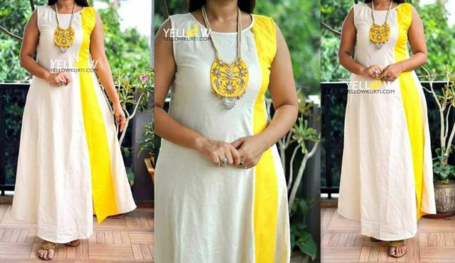 Long Khadi offwhite Kurti with side slit and Yellow Highlights.Beautified with detail embroidered Neck chain included