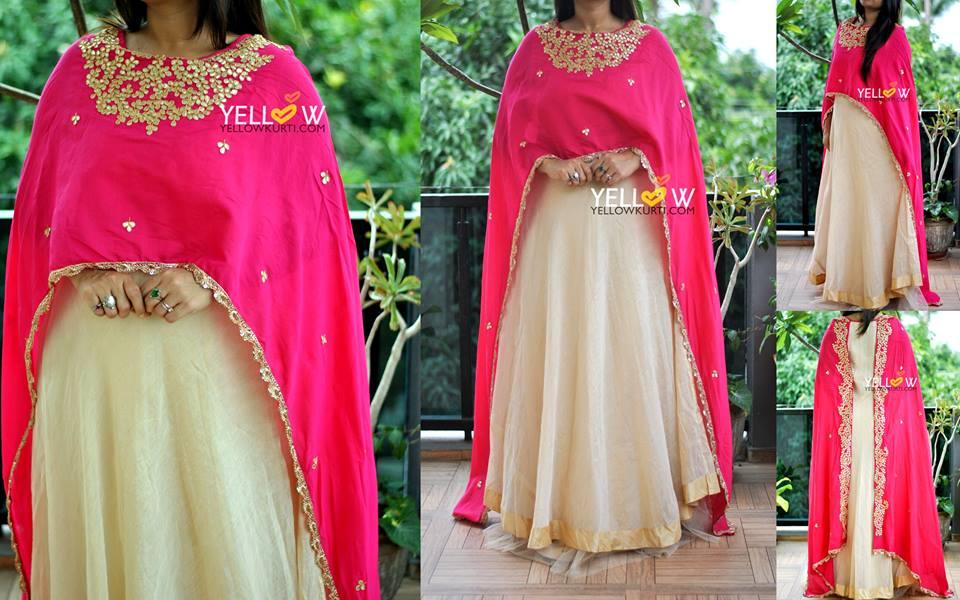 Long Tissue Chanderi gown with layered net frills at flare beautifies with hot pink heavily embroidered Cape- front and back.