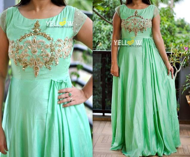 Long Sea green Muslin gown with heavily embroidered yoke and net sleeves detailed with sequins (also on back neckline)