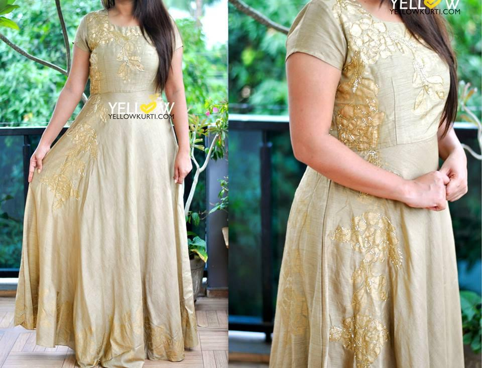 Gold raswilk gown with golden bead work highlights.