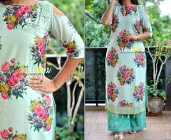 Floral Silk straight Fit Kurti with embroidered cold shoulder teamed up with printed palazzo