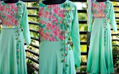 Seagreen shaded long gown with pink floral yoke , tasseled tie ups nad full sleeves