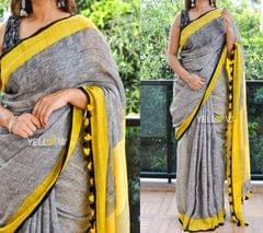 Pure Linen Saree in gray and yellow and striped Pallu.