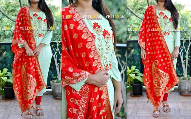 Sea green Muslin Kurti with red floral and beads work teamed up with crape banaras Dupatta . Bottom not included