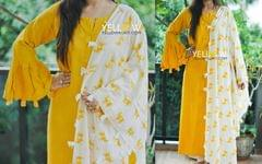 Muslin Cotton Kurti with Ruffle sleeves and tassel edges teamed up with animal Printed Dupatta and unstitched Plain Yellow bottom