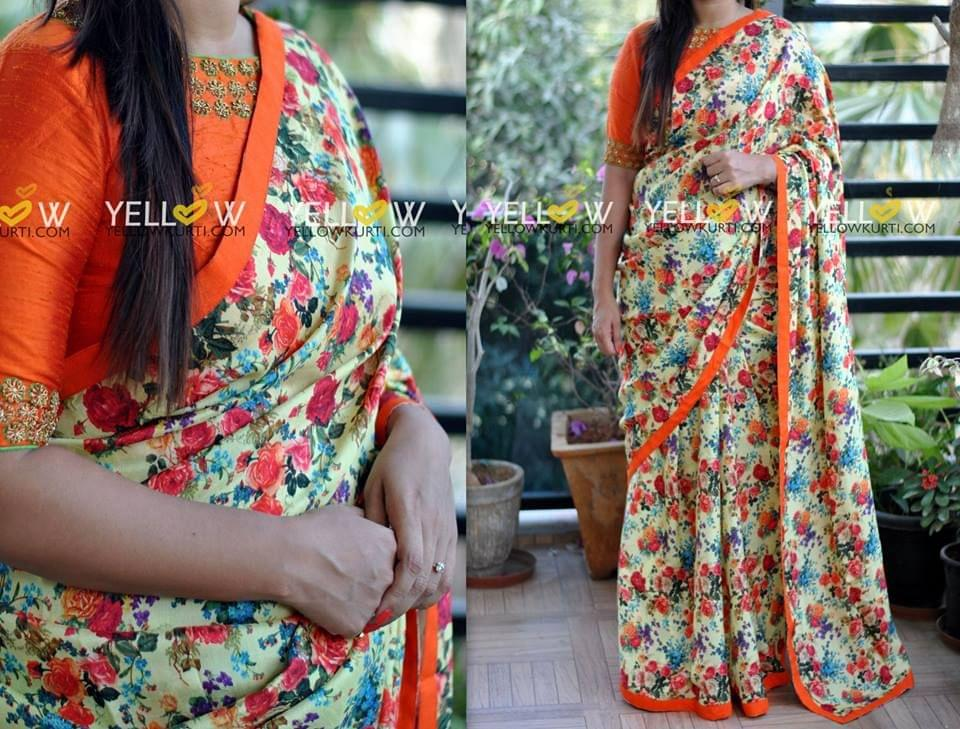 Floral Saree in Muslin Silk with a simple orange raw silk Border teamed up with plain raw silk blouse material