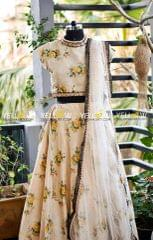 Printed floral skirt and croptp teamed up with heavy net dupatta