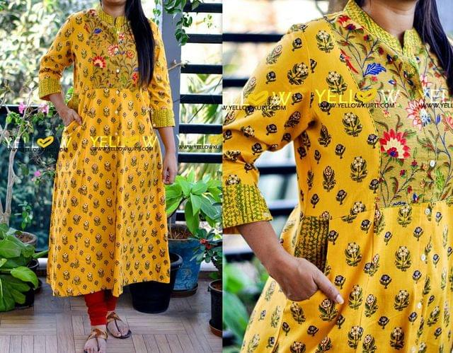 Yellow printed cotton long kurti with floral highlights and pockets