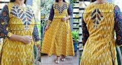 Yellow printed cotton long kurti with kalamkari sleeves and highlights