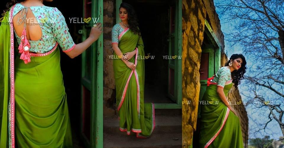Green pure crape Sari with contrasting mirror work borders teamed up with sparrow printed blouse material