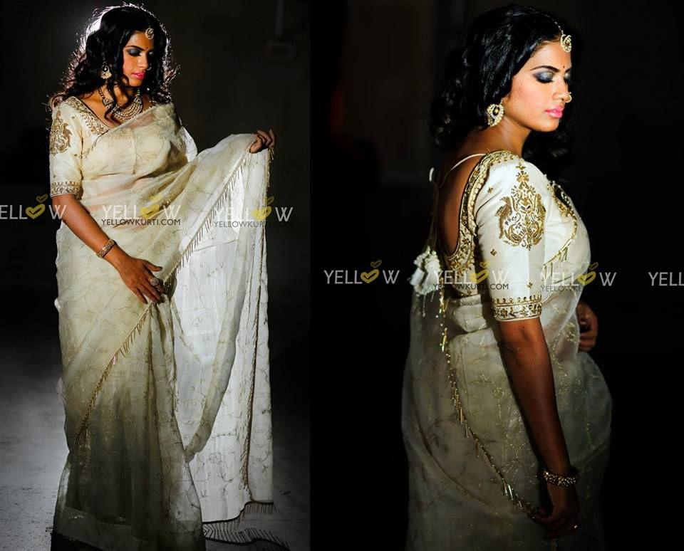 Zari embroidered organza Saree in pearl white with golden pipes Border .