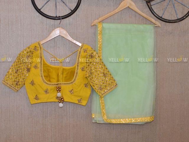 organza saree with contrasting yellow blouse
