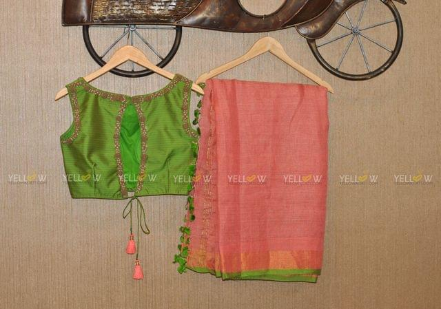 Peach Linen saree with contrasting green blouse