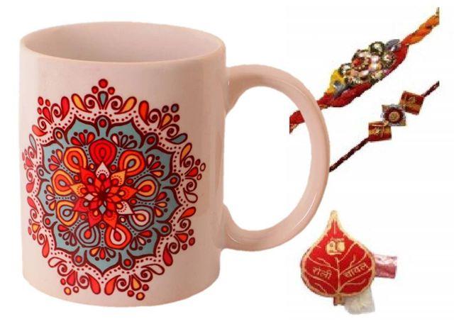 Purpledip Rakhi Hamper: Traditional Design Ceramic Mug, 2 Designer Rakhi & Roli Chawal (rakhi64a)