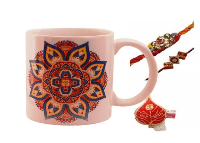 Purpledip Rakhi Hamper For Brother : Ceramic Mug With Ethnic Rangoli Pattern, 2 Designer Rakhi & Pack Of Roli Chawal (rakhi64b)