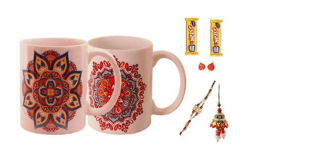 Purpledip Rakhi Hamper For Bhaiya & Bhabhi : 2 Ceramic mug with Ethnic Indian Designs 2 Designer Rakhis 2 Chocolates 5 Star & Roli Chawal (rakhi64c)
