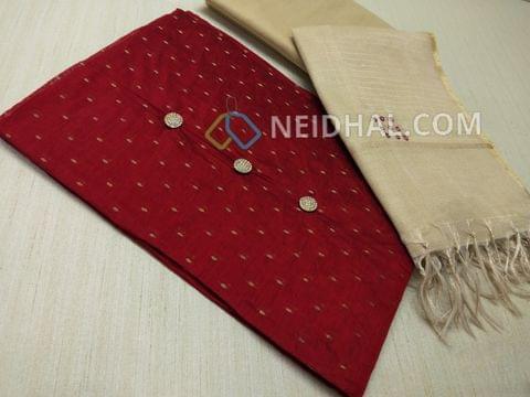Designer Maroonish Red Silk Cotton unstitched Salwar material(Requires lining) with zari butta work on either side, beige silk cotton bottom, foil mirror hand work on Tissue dupatta with tassels