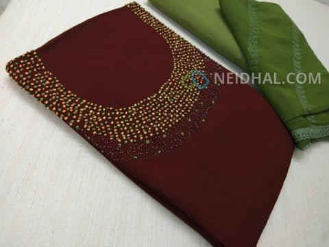 Designer Maroonish Red Georgette unsitched salwar material(requires lining) with Heavy french knot, thread and bead work on yoke, daman taping, Green Silk cotton bottom, Heavy thread and sequins work on green Chiffon duaptta with laces.