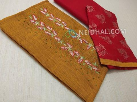Yellow Silk Cotton unsitched salwar material(requires lining) with zari thread, french knot work on yoke, daman patch, Red cotton bottom, dew drops work on Red chiffon dupatta.