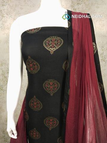 Printed Black Rayon unstitched salwar material with golden prints, maroon Cotton bottom, maroon chiffon dupatta with taping