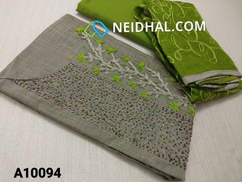 CODE A10094 : Silver Grey Silk cotton unstitched Salwar material(requires lining) with Thread work, French knot work, Pipe work on yoke, Green cotton bottom, Thread work on super net dupatta with taping
