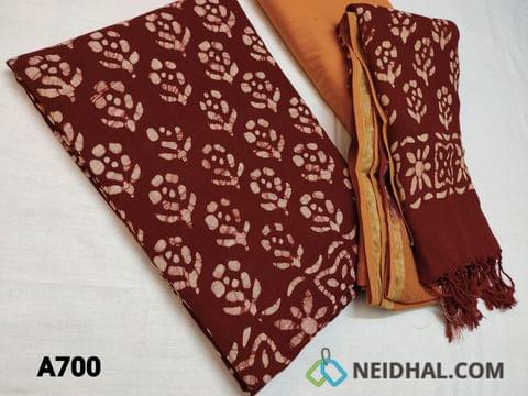 CODE  A700 : Batik Printed Maroonish Red Linen Cotton Unstitched salwar material(requires lining) with batik prints, Yellow cotton bottom, batik printed dual color lenin cotton dupatta with tassels.