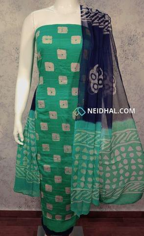 Premium Batik Printed Green Cotton unstitched salwar material with foil mirrorwork and thread work on front side, plain back side, navy blue cotton bottom, dual color chiffon dupatta.(requires taping)
