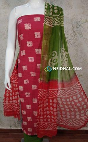 Premium Batik Printed Pink Cotton unstitched salwar material with foil mirror work and thread work on front side, plain back side, green cotton bottom, dual color chiffon dupatta.(requires taping)