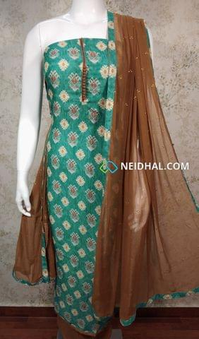 Printed Turquoise Blue Modal Fabric Unstitched Salwar material with potli buttons on yoke, brown cotton bottom, golden dew drops on brown chiffon dupatta with tapings.