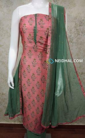 Printed Pink Modal Fabric Unstitched Salwar material with potli buttons on yoke, green cotton bottom, golden dew drops on green chiffon dupatta with tapings.