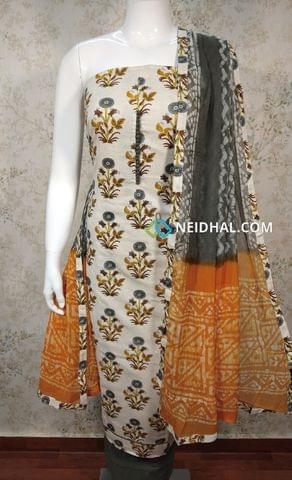 Floral Printed Cream Jute Flex Unstitched Salwar material with potli buttons on yoke, grey cotton bottom, dual color chiffon dupatta with tapings.